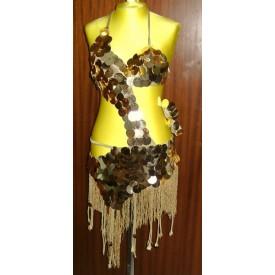 Abito da latino donna realizzato in lycra oro. Abito dalla particolare linea asimmetrica impreziosita da pallettoni oro.
